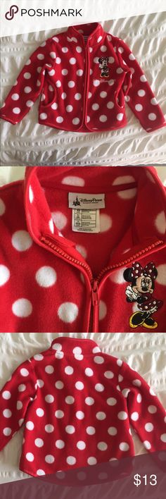 Minnie Mouse fleece zip-up - XXS (similar to 3T) Minnie Mouse girls fleece zip-up - Size XXS.  Authentic Disney Parks/Walt Disney World product.  Red with white polka dots & Minnie Mouse, two pockets on the front.  Size is similar to 3T.  Gently used. Disney Shirts & Tops Sweatshirts & Hoodies