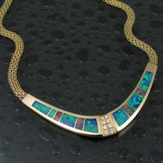Australian opal necklace in 14 karat gold accented by pave` set diamonds. The opal in this necklace is stunning and the craftsmanship is superb. Australian Opal Jewelry, Red Opal, Opal Necklace, Schmuck Design, 14 Karat Gold, Turquoise Bracelet, Jewelry Design, Gemstones, Jewels