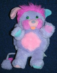 I had this purple popple when I was a kid ;) Popples pop in Popples pop out Popples pop in its what Popples are all about!