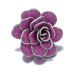 RUBY AND DIAMOND 'ROSE' BROOCH, MICHELE DELLA VALLE Designed as a rose, pavé-set with circular-cut rubies, the borders set with brilliant-cut diamonds, mounted in titanium and white gold, signed Michele della Valle and numbered, maker's marks, case.