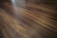 """(Res 2) MAIN HOUSE HARDSURFACE - We showcase metro floor hybrid plus plank in color """"Muhuhu."""" It gives you the warm look of real wood at an affordable price! ..."""