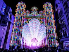 Light Festival in Ghent, Belgium. 55,000 LED lights. The bright cathedral invited visitors to walk through its immense 91-foot high entrance into a fairy tale gallery, surrounded by light and color.