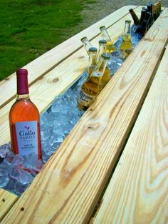 Picnic table with built in ice bucket. Replace the center with a rain gutter. www.custommade.com