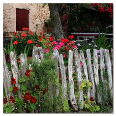 A fence made of rustic uneven old posts