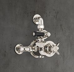 RH's 1900 Classic Wall-Mount Godolphin Dual-Control Exposed Thermostatic Mixing Valve - Black:Lefroy Brooks world-class collection of English-inspired bath hardware is crafted to the highest standards. Faucets and fittings are built from brass, hand assembled, impeccably hand finished and above all, eminently functional. Taking inspiration from the design aesthetic of the early 20th century, the 1900 Classic collection features exposed components and elegant white or black porcelain accen...