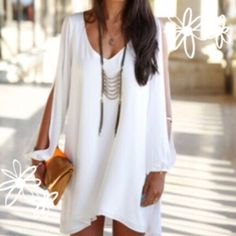 Sweet White Chiffon Boho Dress S Fluttering Layers of white chiffon and slit long sleeves make this sweet Boho dress a must for the coming seasons. Wear as a mini or tunic. Size S. Available in baby blue in separate listing. Dresses
