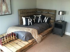 "Headboard for kids bed using pallets... This could work until we get bunk beds! It even says ""Ryan""!"