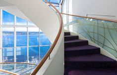 Staircase leading to our library and some of our sea view rooms, with a gorgeous view of Ardmore Bay.