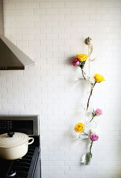 Decorating With Hanging Flower Vases. Click through for the details. | glitterinc.com | @glitterinc