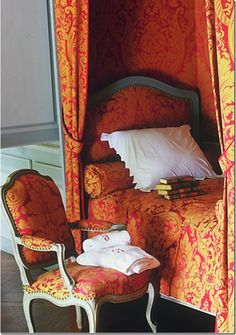 his photo from the Braquenie web site shows a damask named for Chateau Montgeoffroy.  This looks like it was taken in the chateau – the bed and chair are so familiar to others seen in Montgeoffroy.