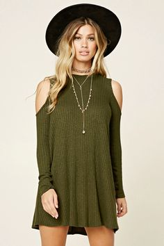 A ribbed, marled knit swing dress featuring long sleeves, a mock neck, and open shoulders.