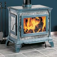 Ours will be grey stone with black cast iron. Soapstone Wood Stove.