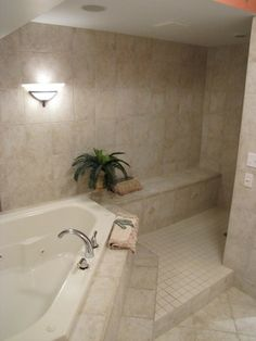 walk in tile shower...love this! Reminds me of my cousins which I've always dreamed of having!