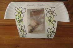 Easy way to watch seeds grow ~ Window garden for kids.  Paper plate greenhouse.