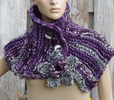 Knited Scarf - Capelet. Unique scarf made . Warm and pleasant to the touch. Beautiful unique design. Color: shadows purple, grey, black, pink Size: One size fits all irregural shape approx 103/30cm 40,55/11,81 materials used: 10%wool, 70%acrylic, 20% shenille button Care instruction: hand