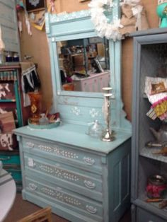 $195 - Is an antique oak 3 drawer chest with mirror that has been painted a soft blue with white accents. The dresser measures 41 inches across the front, 19 inches deep and stands 30 inches tall. The mirror adds an additional 42 inches making the overall height 72 inches. It can be seen in Booth D 8 at Main Street Antique Mall 7260 East Main St ( E of Power Rd ) Mesa 85207  480 9241122open 7 days 10 till 530  Cash or charge 30 day layaway also available