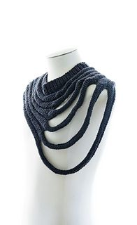 Outbreak is a distressed unisex cowl / scarf. Its distorted oval shape can be pivoted to be work symmetrically or asymmetrically.