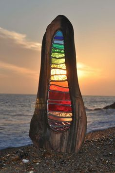 Stained Glass set in wood on beach