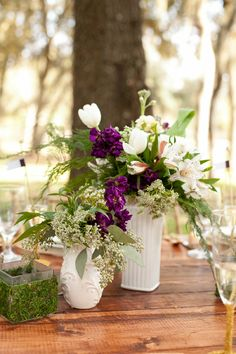 Purple and white centerpieces // photo by http://bumbyphotography.com, via http://theeverylastdetail.com/rustic-chic-champagne-purple-wedding-inspiration
