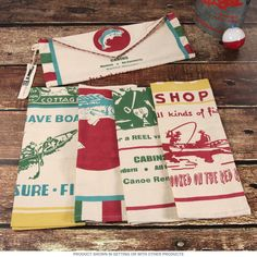 Outdoors Camping Fishing Kitchen Towel Set   Dish Cloths   RetroPlanet.com Add something fishy to your kitchen or camper with this cool set of four Bait and Tackle Dish Towels. Made of 100% cotton, these colorful towels feature four different retro designs that advertise fishing lodges, bait shops, and boats! A fun gift for any fisherman, this kitchen towel set is a must for anyone who enjoys the great outdoors.