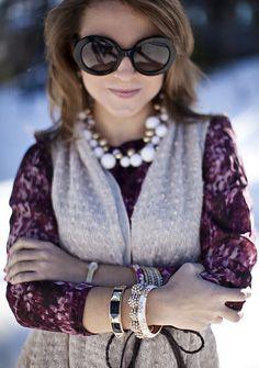 Bubble necklace + stacked bracelets + belted vest.