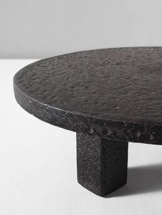 Round Stone Iron Look Cocktail Table   From a unique collection of antique and modern coffee and cocktail tables at https://www.1stdibs.com/furniture/tables/coffee-tables-cocktail-tables/
