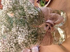Mason jar center pieces wrapped with burlap for #FearlessEventTE Radiate Sisterhood 2013