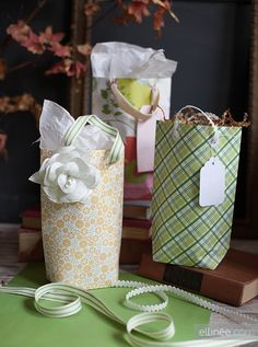 DIY scrapbook sheet gift bags! Much cheaper than gift bags plus you have way more options of prints and styles. Looks like im bulking up at hobby lobby for gift bags for the year.