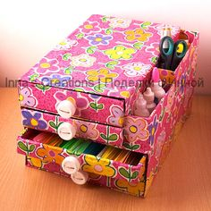 Organizer made from old boxes and wrapping paper