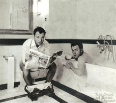 Jude Law. Sitting on a toilet.