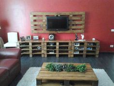 Entertainment Center-Most entertainment centers look dated to me these days. It's a large piece of furniture with room for your TV, stereo, movies etc. Some are free standing and some are built in. I like this one because of it's rustic look. It is made out of recycled shipping crates. A good DIY