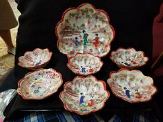 This is a beautiful Hand painted Large Geisha Girl Bowl with 6 smaller bowls. In excellent condition, no chips or cracks or crazing. The bowl is 8 1/2 inches in diameter and 2 1/2 inches tall.  The smaller bowls are 5 inches in diameter and is 1 1/2 inches tall. All bowls are hand painted with the same design and are all shaped the same, and has a beautiful scalloped edging. Each piece has a burnt orange trimmed and the colors are really stunning. Truly a lovely set. Great piece for your…