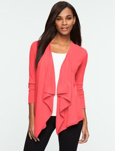 I have this cardigan in this color and it's one of my favorite spring pieces. 100% cotton. TALBOTS FLYAWAY CARDIGAN.