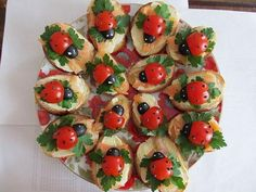 Ladybug appetizer featuring tomatoes, olive, parsley with cream cheese on sliced baguettes...