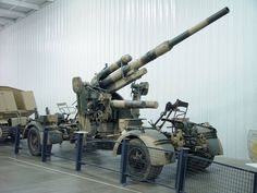 The 88 mm gun (eighty-eight) was a German anti-aircraft and anti-tank artillery gun from World War II. It was widely used by Germany throughout the war, and was one of the most recognized German weapons of the war. Development of the original models led to a wide variety of guns.  The name applies to a series of guns, the first one officially called the 8,8 cm Flak 18, the improved 8,8 cm Flak 36, and later the 8,8 cm Flak 37...