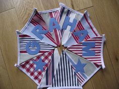 handmade personalised boys bunting with IKEA stripe fabric and letters hand cut and appliqued in blue felt - Breifne Cottage Designs