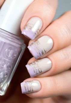 Light Purple nail art design. Simple yet beautiful Purple nail art design with hints of silver glitter polish aligned on top.