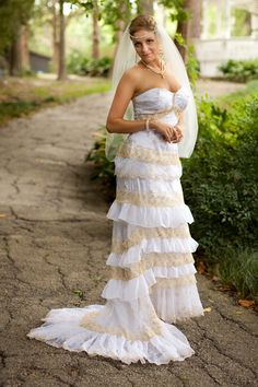 This gorgeous bridal dress is made of white and gold lace, satin and chiffon.