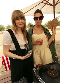 Alexa Chung (with Tennessee Thomas) toughens up her sweet playsuit with a military-style shirt.