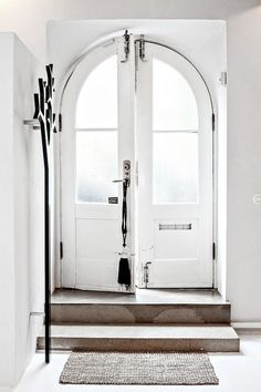 arched front door + french doors