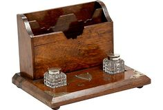 Antique English oak desk box with letter holder, two pressed glass inkwells, and brass framing on the corners, 1880s.
