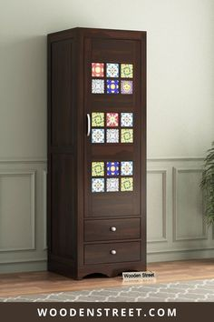 Boho single door wardrobe is a fine example of a furniture wrapped in colors. It has two drawers below with a cupboard on top. This cupboard is carved with Bohemian tiles embossed upon it. A combination of fabulous wooden finish with color pops of Bohemian tiles makes it a finely embellished wooden furniture. This furniture is made with sheesham wood. It is available in three finishes of honey, teak and walnut finish. Wooden Furniture, Bedroom Furniture, Single Door Wardrobe, Wooden Street, Wood Sofa, Single Doors, Walnut Finish, Home Decor Kitchen, Cupboard