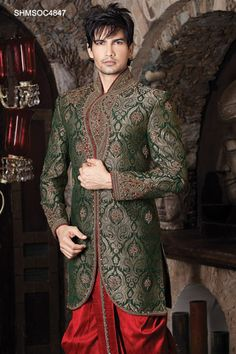 green, gold, and red sherwani