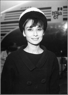 """Audrey Hepburn arrives at Heathrow airport to attend the European film premiere of """"Breakfast at Tiffany's"""", 1961"""