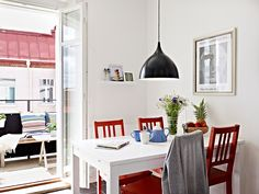 White dining table with red dining chairs!