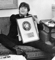 John with The Beatles Gold Record from Capitol