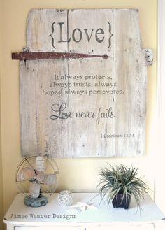 Handpainted wood barn door sign with love verse. $150.00, via Etsy.