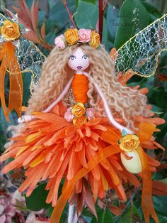 "Here we have the beautiful Marchaline...shes a whopper!! at approx 11"" tall And 10"" wide she is a lot bigger than the others..She has large wire wings which have a gossamer finish...her hair is adorned with a rose crown...She carries a wishing wand in one hand and a little Easter egg in the other! she can be hung or can sit as she is fully poseable...She will arrive wrapped in layers and layers of tissue paper making her the perfect gift.."