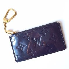 Louis Vuitton Vernis Patent Monogram Key Pouch Gorgeous Louis Vuitton Vernis Patent Leather pouch keyring. Zipper top, glossy, shimmering patent in a gorgeous deep steel blue/grey/purple tone. Looks darker indoors. Great condition. Made in Spain. Date code shown in last photo. Louis Vuitton Accessories Key & Card Holders