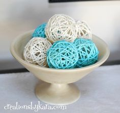 super easy!! rattan balls from dollar store and spraypainted. Tip: spraypaint the balls in a shoebox while rolling them around, no sticking to the box while they dry.  VIA: creationsbykara.com